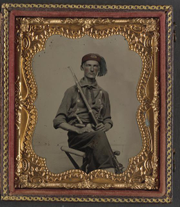 [Unidentified soldier in Union uniform and fez with Model 1855 rifle musket and pepperbox revolver]