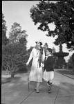 Mme. Evanti [Lillian Evans Tibbs, with son in park, walking : acetate film photonegative]