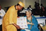 Eugene Redmond presenting a card to Katherine Dunham (1 of 2)
