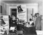 [Interior view of NAACP branch office in Detroit, Michigan, showing NAACP membership drive posters]