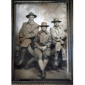 Three African American men in coats and hats