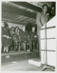 Paul Robeson at a podium, delivering a speech
