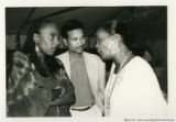 Susan Taylor and two others talking together