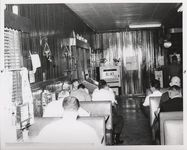 Mississippi State Sovereignty Commission photograph of men sitting and eating in booths inside Stanley's Cafe, Winona, Mississippi, 1961 November 1