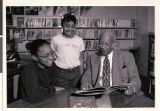 Photograph of Principal Theron Goynes with students, circa 1990
