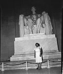 [African American woman, identified as Carol Brice, standing in front of Lincoln statue, Lincoln Memorial : black-and-white photonegative,] June, 28, 1947
