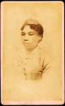 Portrait of unidentified young woman wearing ribbon on head