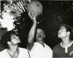 Franklin Harlow refereeing his sons, Howard and Philip, in a basketball game on Baker Street. Howard attended Albany State (Georgia) and Philip attended LeMoyne College