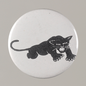 Pinback button with a black panther on it, from the MMM 20th Anniversary