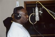 Almighty Kay Gee of the Cold Crush Brothers recording a commercial for Funkmaster Flex, D&D Studios