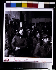 [Black fighter pilot series--Colonel Benjamin O. Davis seated with pilots at briefing in Italy]