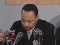 WSB-TV newsfilm clip of Dr. Martin Luther King, Jr. condemning the Georgia state legislature for refusing to seat Julian Bond at a press conference held in Atlanta, Georgia, 1966 January 13