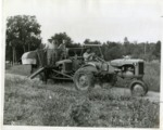 Photo of Men on Allis Chalmers Tractor