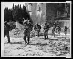 [African American soldiers on patrol near bombed buildings, somewhere in Europe]
