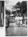 Three Maryknoll Sisters walking with a group of student nurses, Los Banos, Philippines, January 7, 1928