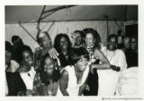 Group laughing with Oprah Winfrey