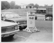 "Mississippi State Sovereignty Commission photograph of the parking lot of Stanley's Cafe and the Trailways bus depot with a sign reading ""Hot biscuits for breakfast,"" Winona, Mississippi, 1961 November 1"