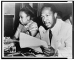 [Josh White testifying before the House Un-American Activities Committee; his wife sits beside him]