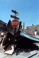 "Riots; Detroit; Race Riot.--Windows boarded up - 1 picture.--Stop sign in wreckage - 1 picture.--""Peace on Earth"" sign on building - 1 picture.--Used in ""A Time of Tragedy"". A special section, Re: Riot. Published by Det. News Aug. 11, 1967.--Enc. 3 negs."