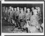 Thumbnail for [First African American members of the Women's Army Corps assigned to overseas duty get off a train at night in England]