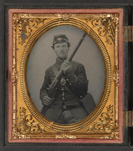 [Private Jacob Harker of Company C, 120th Ohio Volunteers in uniform with musket and haversack]