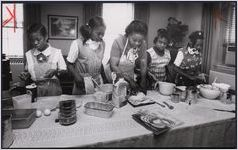 Girl Scouts making bread with Mary Scruggs, Atlanta, Georgia, March 1978