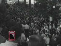 Series of WSB-TV newsfilm clips of integration at the University of Georgia including crowds observing the arrival of African American students, students answering reporter's questions about integration and rioting in protest, and the African American students' return to Atlanta, Atlanta and Athens, Georgia, 1961 January 11