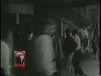 WSB-TV newsfilm clip of civil rights workers holding a sit-in and picketing in downtown Atlanta, Georgia, 1960 November 25