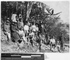 Two Belgian priests and Igorot school boys on a picnic, Philippines, ca. 1900-1920