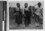 Three girls carrying babies, Korea, ca. 1920-1940