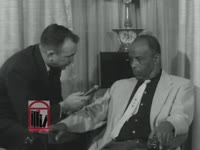 WSB-TV newsfilm clip of Marion Page, executive secretary of the Albany Movement, interviewed by an unidentified reporter regarding the Albany Movement's efforts to secure civil rights for African Americans in Albany, Georgia, 1962 January 31