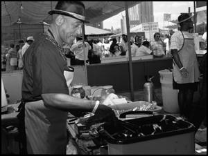 [Man Cooking in Soul Food Booth] 18th Annual Texas Folklife Festival