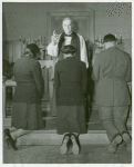 An Episcopal Bishop confirming African American Lieutenants Rosemary Vincent and Hallie M. Brown and an unidentified soldier, as they kneel before him
