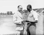 Sprinter Ralph Metcalfe with coach Conrad Jennings, 1932