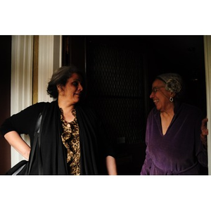 Adelaide Cromwell laughs with Lolita Parker, Jr. in the doorway of Cromwell's home