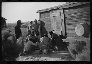 [Untitled photo, possibly related to: Negroes shooting craps behind tenant house, disposing of their cotton money on Saturday afternoon, Marcella Plantation, Mississippi Delta, Mississippi]