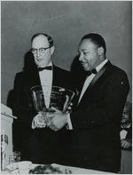 Martin Luther King, Jr., with Rabbi Jacob M. Rothschild, at South's first racially integrated banquet, held at Dinkler Plaza Hotel, Atlanta, Georgia, on January 27, 1965, honoring King for winning the Nobel Peace Prize, the year before