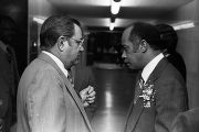 Mayor Richard Arrington talking to with a man in a hallway on the day of his inauguration as the first African American mayor of Birmingham, Alabama.