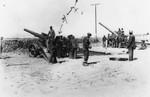 Men taking artillery instruction