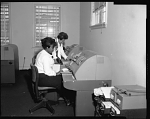 Industrial Bank of Washington Ga. [Georgia] Ave. Branch (Employees at Machines), March 1964 [cellulose acetate photonegative]