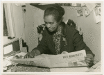 Claudia Jones reading the West Indian Gazette, London, 1960s