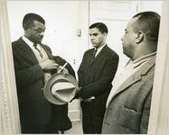 Hamilton Holmes, one of the first two African-American students to integrate the University of Georgia (center), with his attorney D.L. Hollowell (left), and his father Alfred Holmes, Athens, Georgia, January 9, 1961