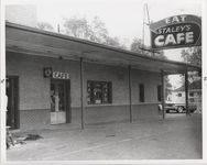 Mississippi State Sovereignty Commission photograph of the exterior of Stanley's Cafe showing the front door and window, Winona, Mississippi, 1961 November 1