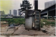 """Shack built from salvaged materials sits on a lot in """"Hutsville,"""" a homeless community beneath a bridge in Downtown Atlanta, near the Martin Luther King Jr. Boulevard viaduct, Atlanta, Georgia, August 23, 1992"""