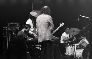 Miles Davis in performance: Cedric Lawson (keyboard), Reggie Lucas (guitar), Dave Liebman (back to camera), Al Foster (drums)