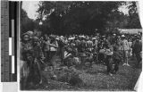 Large group of people standing in a field, Borneo, ca. 1920-1940