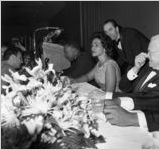 Martin Luther King, Jr.'s Nobel Peace Prize recognition dinner, National Conference of Christians and Jews, Dinkier Plaza Hotel, Atlanta, Georgia, January 27, 1965. King and Coretta Scott King are in center