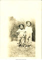 Tom and Albert Rodriguez (ages 3 and 4) standing in front of tall grass, Bettendorf, Iowa, September 16, 1924