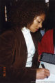 Terry McMillan autographing a book
