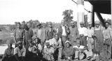 African American men standing by river